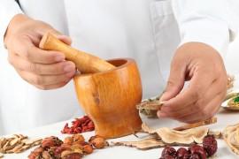 Herbalist grinding dried herbs.